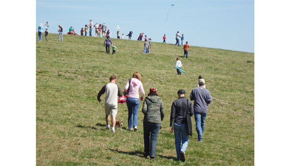 Families make their way up Hawks Ridge Hill behind FENCE for last year's Go Fly A Kite Day. (photo submitted)