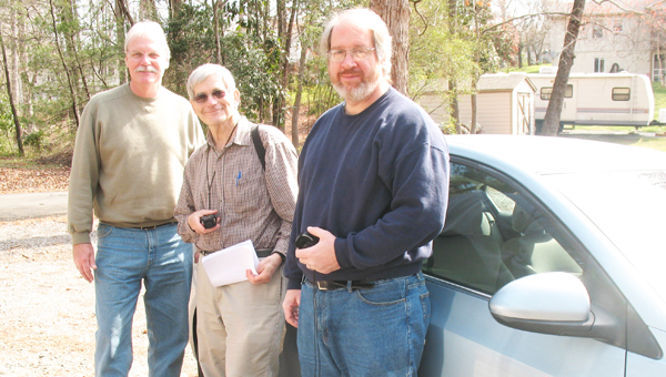 For geocaching enthusiasts Richard Bauer of Columbus, Mark Levin of Columbus and Mike Reeves of Saluda, Saturday at Brookwood Park was a success. With clues in hand to find the hidden cache,  they were smiling walking back to their car as they were off to the fountain in Landrum to try their luck finding another cache. The sport of geocaching, which started in 2000, can be found throughout the world, more information is available at geocaching.com. (photo by Anne Regan)