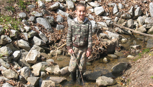 What 9-year-old boy seeing water doesn't want to play in it? That's just what Kaden Morton, properly dressed with boots and all, was having fun doing on a recent Saturday in the creek at Brookwood Park in Landrum. (photo by Anne Regan)