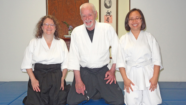 The Aikido Club of Try-Co-Lan tests were held April 20. Sheri Rardin was promoted to second Kyu rank, the fourth test on the way to her black belt. Cherry Pearson achieved fourth Kyu rank.   Kyu rankings begin with the 6th kyu and progress to first kyu, which is one rank below shodan (black belt). Shown from left to right are Sheri Rardin, Paul Buchanan (chief Instructor) and Cherry Pearson. (photo submitted by Anne Buchanan)