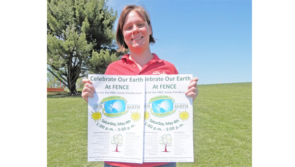 Nature Education assistantnt Kristy Burja shows off the Celebrate Our Earth at FENCE posters that are being posted all over Polk County. (photo submitted by Carrie Knox)