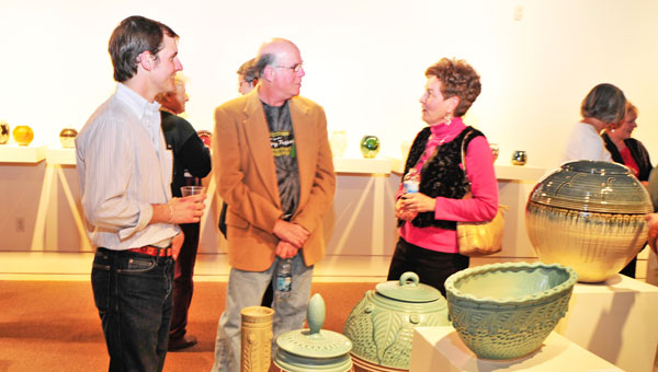 """Visitors enjoy the opening reception of """"Older than Dirt,"""" one of the Upstairs' current exhibits. (photo by Mark Schmerling)"""