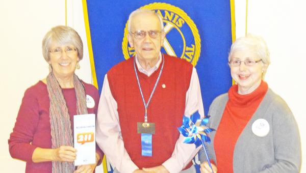 Lou Parton (at right), DSS director, and Linda Greensfelder (at left), director of individual assessment, at Expert Advocates in Selection International, LLC. (EASI-Consult) spoke to the Tryon Kiwanis Club March 27. The two spoke about an effort to launch a 2-1-1 program in Polk County that would offer a central number to call for information. Parton also reminded the club that April was Child Abuse Awareness month. Greensfelder and Parton are pictured with Dick Belthoff, Kiwanis club member. (photo by Boyd Correll)