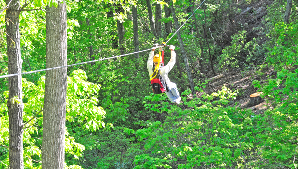 Staff members enjoying their first ride through The Gorge Zip Line Canopy Tour, during their weeklong training. See more photos at www.tryondailybulletin.com. (photos by Mark Schmerling)