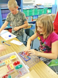With materials funded through a grant from the Polk County Community Foundation, Brandon Cantrell and Samantha Wilcox, rising fifth graders at Saluda Elementary School, work together to build electrical circuits this past spring. (photo submitted by Ronette Dill)