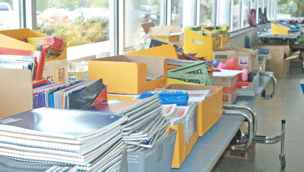 Outreach will provide school supplies to kids during its back to school event for clients. (photo by Samantha Hurst)