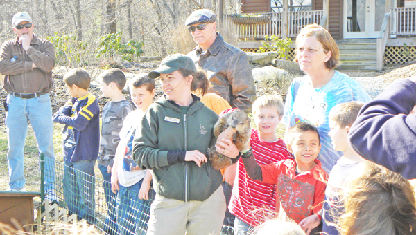 Emily Walker with a woodchuck at an education program at Chimney Rock State Park. (photo submitted by Pam Torlina)