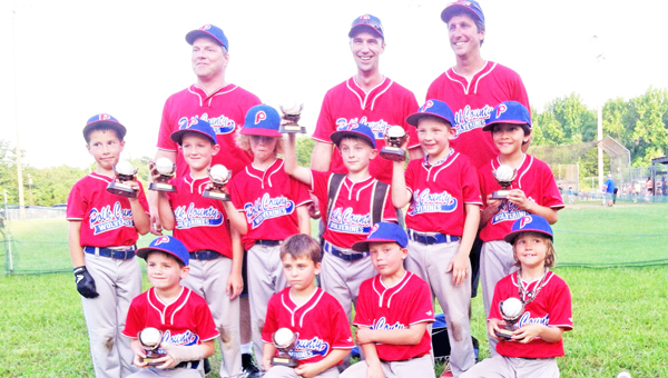 """The Polk Red team won this year's regular season for Division One 7/8-year-olds. Teammates pictured are top row, left to right: assistant coach Merlin Troyer, head coach Joey Whiteside, assistant coach Robert Carter; middle row, left to right: Brandon Troyer, Auston """"Buster"""" Ledford, Cole Pereira, Carson Metcalf, Bryson Jones and Larry """"Neon"""" Traber; front row, left to right: Mark Frantz, Cooper Snyder, Elliott Whiteside and Lawson Carter."""