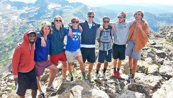 John Spencer Wolfe of Tryon with NC State Cross Country teammates and friends while training for a month in Boulder, Colo. This town is on the eastern edge of the Rockies, with 200 miles of off-road running trials. Here the runners take a break from running to hike up South Arapahoe Peak (13,280ft. elevation). Shown are: Vibushan Sivakumaran (NCSU), Sam Roberson (NCSU), Sam Parsons (NCSU), John Spencer Wolfe (NCSU), Isaac Presson (UNC), Frances Hernandez (Auburn), Thomas Graham (Stanford) and Craig Engels (NCSU). (photo submitted by Nina Wolfe)