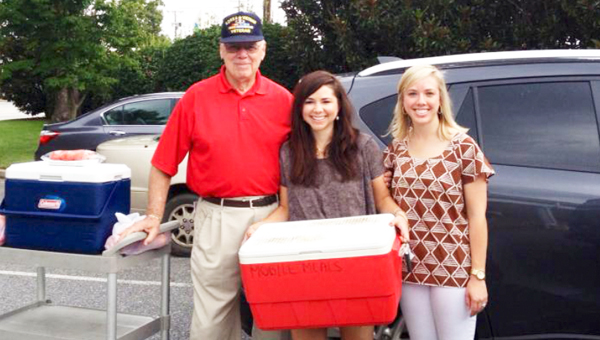 Pictured are LTC John Albree of Columbus,Leslie Bailey and Neely Bailey delivering Mobile Meals. Vic Bailey III, president of Vic Bailey Automotive in Spartanburg and his daughters deliver a Mobile Meals route everyThursday in their area. LTC John Albree is a frequent customer of theirs and was interested in finding out more about Mobile Meals. (photo submitted by John Albree)
