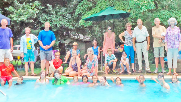 Polk County Big Brothers Big Sisters youth and mentors enjoy an end of summer pool party. (photo submitted)