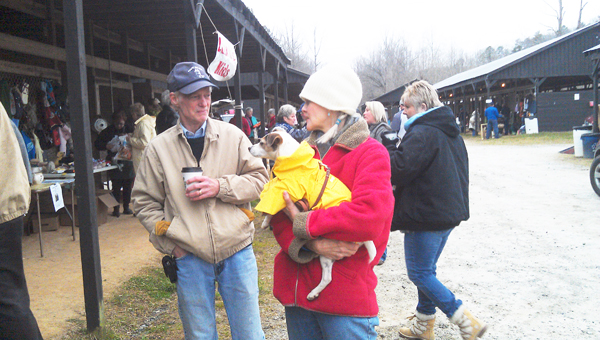 Gail Stockdale and Alice (her dog friend owned by Cindy and Ray Norden), enjoyed looking for great finds during FENCE's spring yard sale. (photo submitted)