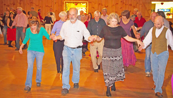 Someone looking to hit the dance floor can travel to Saluda for the next Contra Dance set for Tuesday, Aug. 27 at the Party Place and Event Center. Lessons will run from 7-7:30 p.m. with dancing running from 7:30-10 p.m. Caller is Keith Eustis, with music by fiddler Alan Dillman and the Skeezicks. There is a small admission fee. For directions to the Party Place, visit www.partyplaceandeventcenter.com. Come and enjoy dancing in the cool air-conditioned venue. (photo submitted by Mary Ann Hester)