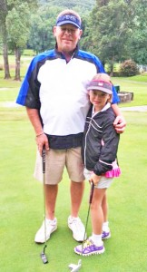 Girl's division winner Ellie Mitchell, playing with her father, Mike Mitchell.