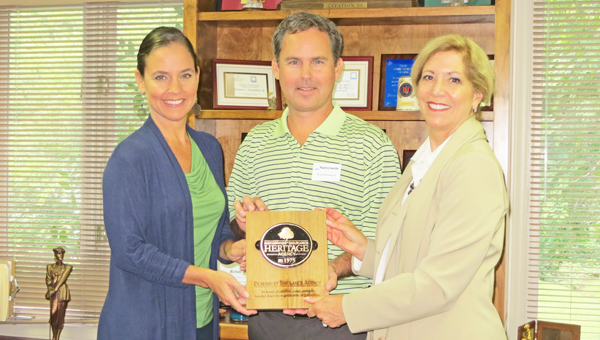 Pictured from left to right are Agent Renae Dusenbury Waldman,  Agent Trey Dusenbury, and Nationwide Sales Manager Beth Trotter presenting the Nationwide Heritage Plaque.  (photo submitted)
