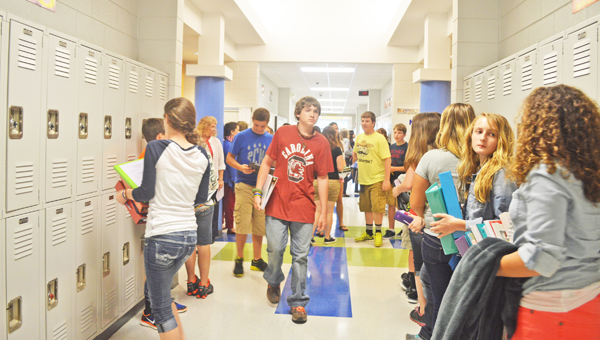 Eighth-graders at Polk County Middle School switch between classes during the end of their first day Monday, Aug. 26. PCMS Principal Hank Utz said the school enrolled about 30 more students this year than last year. (photo by Samantha Hurst)