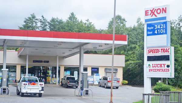 """Columbus council hopes to limit the number of sweepstakes machines allowed within city limits. Sweepstakes machines are currently in gas stations near the I-26 interchange including the Exxon station shown here with a sign reading, """"Lucky Sweepstakes."""" (photo by Samantha Hurst)"""