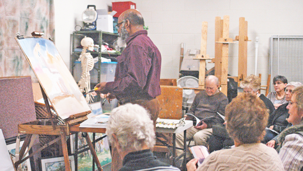 Tryon Painters and Sculptors hosted plein air artist Dwight Rose of Spartanburg at its Nov. 27 Art, Wine & Cheese event. TPS plans to hold five Art, Wine and Cheese events in total this year. (photo by Samantha Hurst)