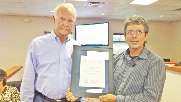 Patriots Salute to Veterans Association President Otis Livingston (left) presented Polk County Commissioner Chairman Michael Gage with a certificate on Monday, Aug. 19 for Polk County being selected by the Veterans Day National Committee as a regional site for the celebration of Veterans Day 2013. Livingston said only 62 awards were presented nationwide last year. The county's first Veterans Day parade will be held this year on Nov. 11 in downtown Columbus. (photo by Leah Justice)