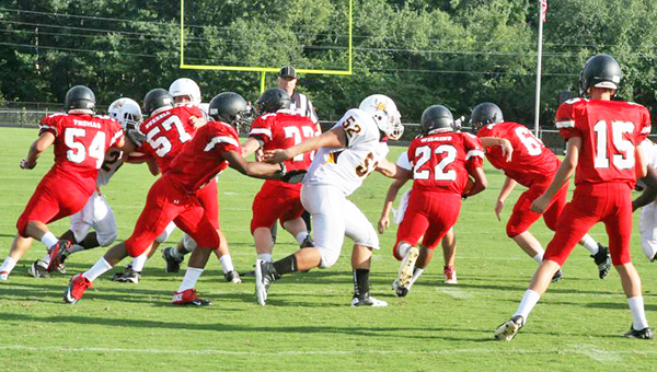 The North Carolina –South Carolina Fellowship of Christian Athletes football jamboree held at Boiling Springs High School Saturday, Aug. 10 involved eight teams, four from N.C. and four from S.C. There were eight quarters to the game, with each team playing for two quarters. Landrum High School beat Thomas Jefferson with a score of 14 to 7 at the end of their two quarters. Top: Jo Jo Wilkins (no. 22) takes off for another run. (photo by Lorin Browning)