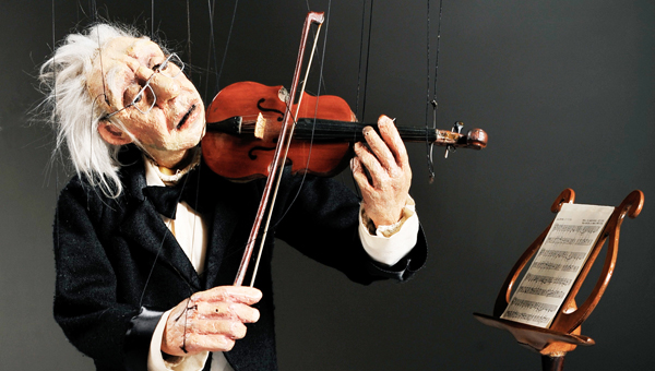 """Right: Maestro Janos Zalinka, pictured here, convincingly """"plays"""" a violin solo note from Ralph Vaughn's Lark Ascending. Maestro, part of the puppet cast of the award winning program Life in Motion by Cashore's Marionettes, will be presented at Tryon Fine Arts Center on Saturday, Nov. 2 at 8 p.m. Tickets are available by calling 828-859-8322 or by visiting www.tryonarts.org. (photo submitted)"""