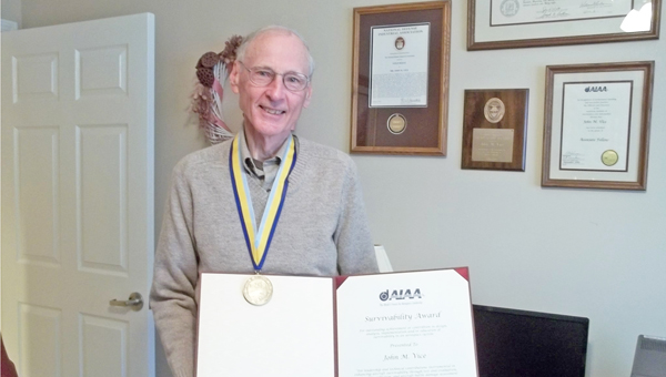 Ret. Maj. John M. Vice holds his award from the AIAA. (photo by Ernie Kan)
