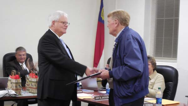 Cowan receives a plaque for his years of service from Chairman Geoffrey  Tennant at the Polk County Board of Education meeting on Dec. 8. (Photo by Alissa  Fiorillo)