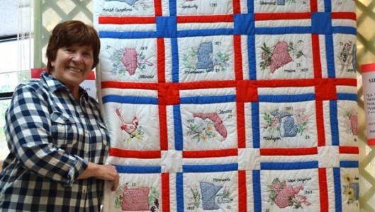 A beautiful quilt of obvious heritage quality was found in a box of donations to the Second Chance Thrift Store in Columbus in January. Recognizing its value as a significant piece of art and discovering the artists names on the back of the quilt inspired Ruby Drew, pictured, to go on a treasure hunt to find those who made it.  (Photo submitted by Ruby Drew)
