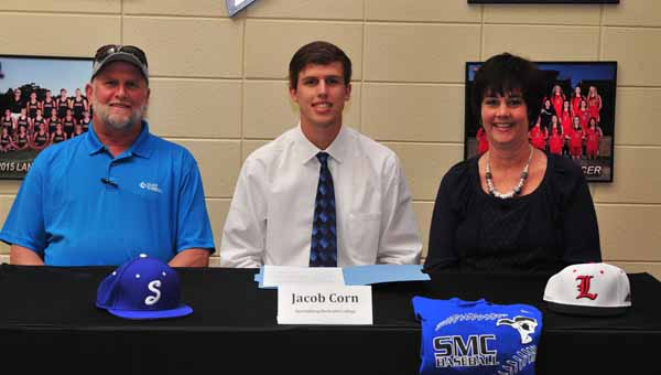 This fall, Andrew Mitchell, seated, currently a senior at Landrum High School, will be attending Eastern Nazarene College, and playing basketball for the Lions on a scholarship. On May 6, Mitchell signed his intent to attend ENC and play basketball there. In the back row, are, from left, LHS Principal Jason McCraw, men's basketball coach Lyn Smith, and Mitchell's father, Jeff Mitchell.