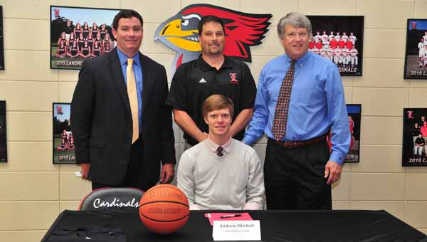 Landrum sports fans will be losing a versatile and talented performer when Jacob Corn (front row, center) attends Spartanburg Methodist College on a baseball scholarship this fall. Corn, who made it official on May 6 that he'll attend SMC and play baseball there, is flanked by his parents Keith and Robbin Corn. (Photos by Mark Schmerling)