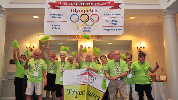 """""""Let the games begin"""" was the call on Tuesday, Oct. 11 at Tryon Estates, Columbus, when residents of Tryon Estates and those of four other Acts Retirement Life Communities went for the gold in eight OlympiActs activities, including brain games, bocce, billiards, walking relay and swimming pool relay. Members of the Tryon Estates team show their enthusiasm before the games commenced."""
