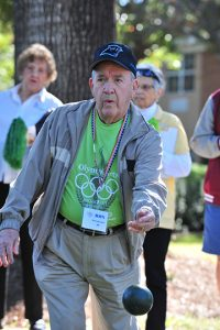 Tryon Estates resident Ron Rosenberger shows his concentration and form in the bocce competition.