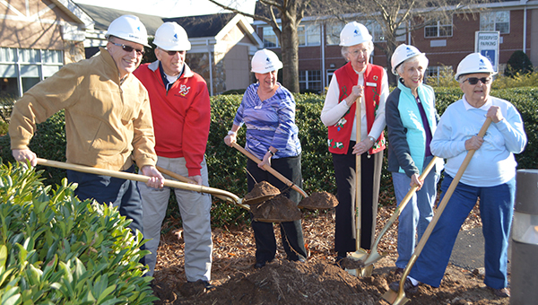 Tryon Estates has announced a $10 million renovation project beginning in 2017 that includes upgrades to the dining facilities and auditorium on campus. The project, which will take at least a year to complete, is being done by Edifice General Contractors and was designed by THW Design. Tryon Estates residents took part in  a photo opportunity with golden shovels as part of the announcement ceremony Tuesday, Dec. 20.  (Photo by Michael O'Hearn)
